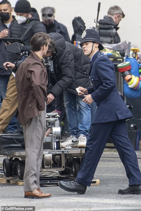 Boy in blue: Harry appeared very suited to his new uniform