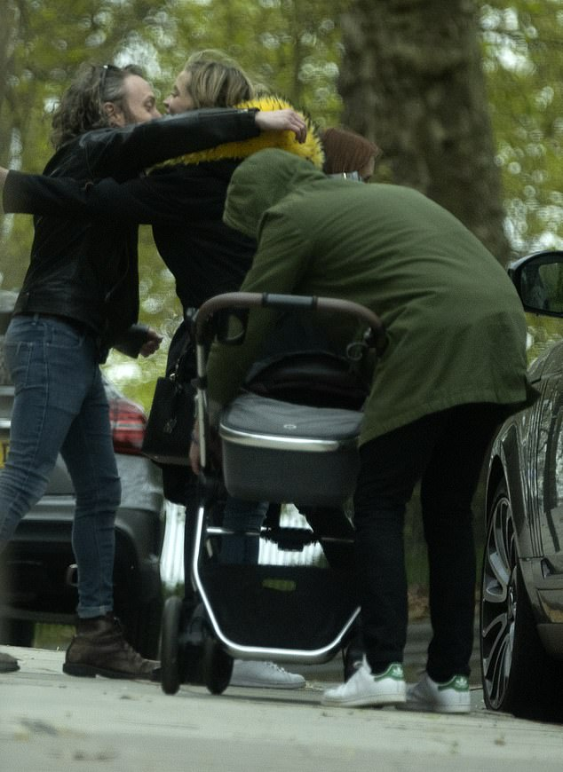 Outing: At one point, Love Island narrator Iain was seen tending to his baby girl as he prepared to put her in the car, while his wife said her farewells to the friends