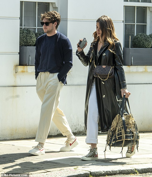 Going strong: Niall Horan and his girlfriend Amelia Woolley appeared to be in high spirits as they enjoyed a rare outing in London on Tuesday