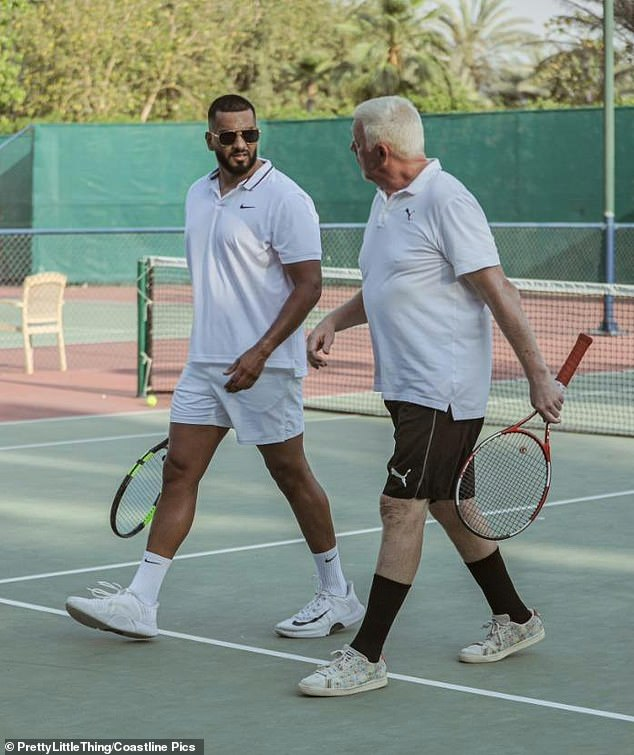 Dapper: Umar went for Wimbledon chic as he stepped out onto the all-white court and paired a Nike polo shirt with matching shorts, socks and sneakers
