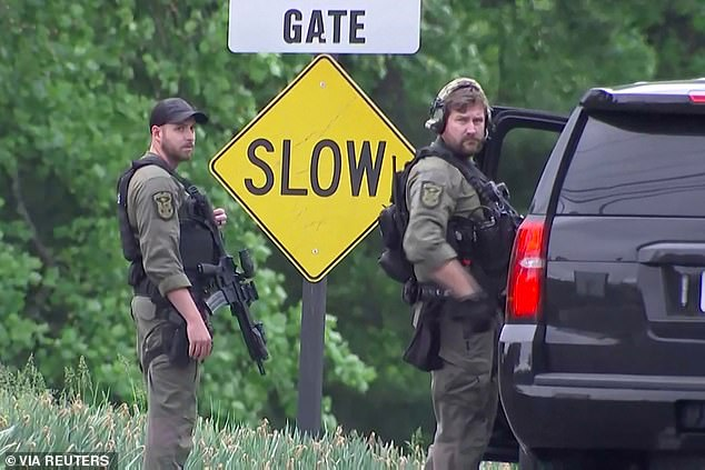 Law enforcement officers guard near the entrance to the headquarters of the Central Intelligence Agency (CIA) after a security incident in Langley, Virginia on Monday afternoon