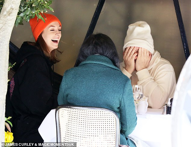Love it: Beauty certainly seemed in a good mood as she burst out laughing