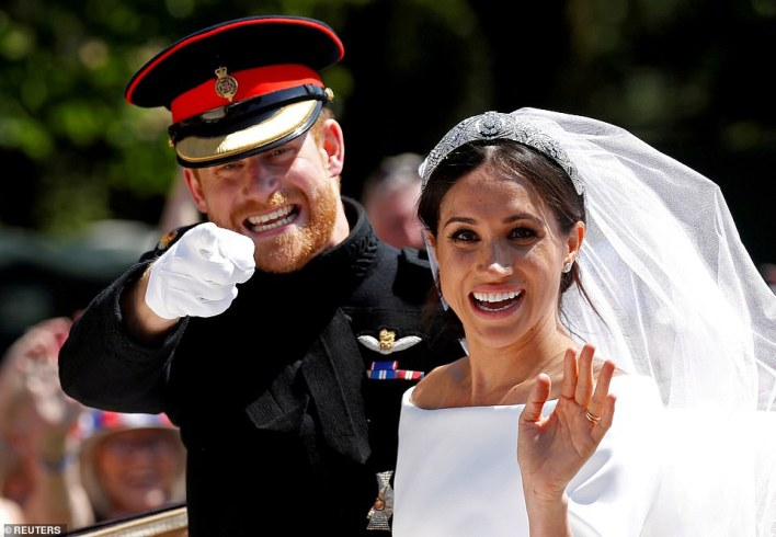 Prince Harry and Meghan as they ride a horse-drawn carriage after their wedding ceremony at St George's Chapel in Windsor Castle on May 19, 2018
