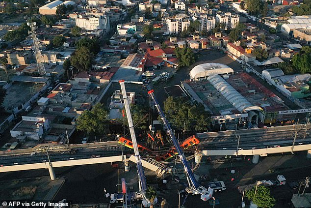 An aerial view shows the site of a metro train accident after an overpass partially collapsed in Mexico City on Monday night. At least 24 people were killed and 79 were injured. Two cranes were set up to support the elevated train line from plummeting to the ground. Two trains remained dangling from the tracks early Tuesday