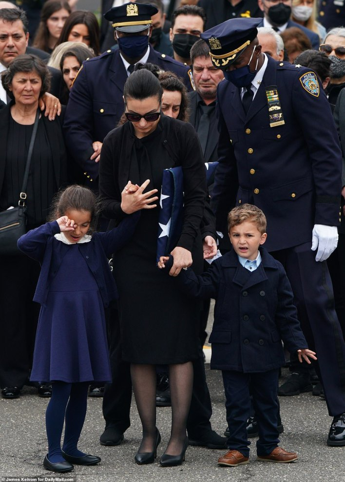 The officer's wife Irene and two children gathered for the service. His grieving widow gave an emotional tribute to the 'love of my life' and 'awesome dad'