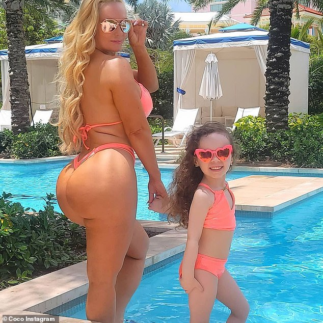 Vacation time: Mom, 42, and five-year-old wore pink swimsuits from Wild Blush Bikinis as they posed outside at the Grand Hyatt Baha Mar in Nassau, Bahamas