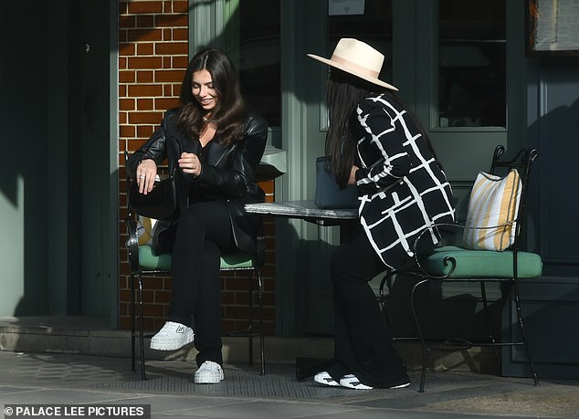 Two's company: Francesca was spotted alongside a pal as they dined al fresco at The Ivy