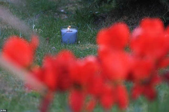 A lit candle marks one week since the death of Julia, at her family home in Snowdown, near Aylesham, East Kent