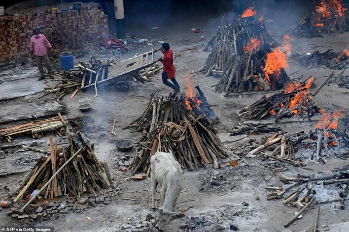 Funeral pyres of people who died due to the Covid-19 coronavirus are seen at a cremation ground in New Delhi on May 4, 2021