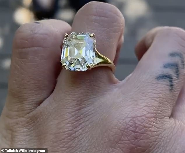 Joy: Shortly after setting up the photo album, she uploaded a brief video that offered a close-up view of her sparkling ring which appeared to have a yellow diamond.