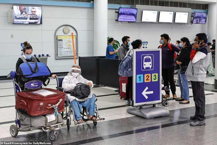 Passengers arrive at O'Hare Airport in Chicago from a flight from Delhi on Tuesday morning