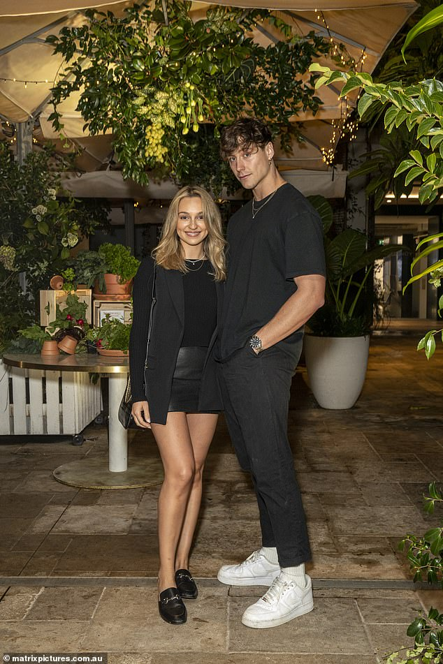 Locky is a distant memory!  Bachelor Bella Varelis cuddled with her new boyfriend Will Stokoe as she attended the launch of Simon Hill's new plant-based diet book in Bondi on Tuesday.