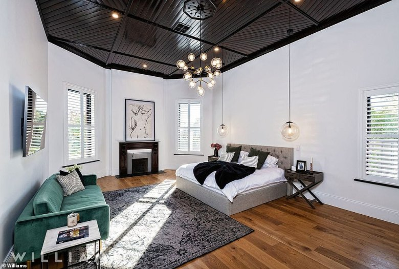 All four bedrooms are king-sized, with the downstairs master boasting a hotel-inspired ensuite and the original timber herringbone ceiling (pictured) which was painstakingly preserved in the building works