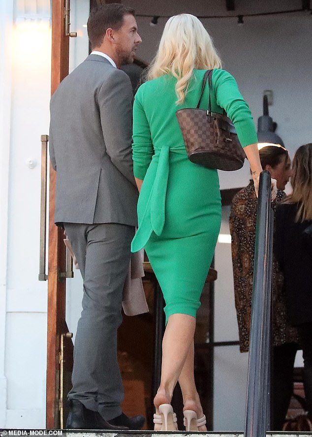 Thanks baby!  Never the gentleman, Joshua was spotted wearing Sophie's camel coat as they walked into the room.