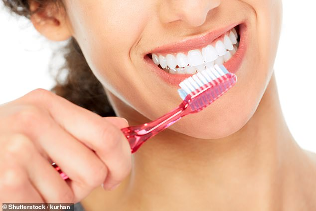Researchers at the Academic Centre for Dentistry in Amsterdam found brushing your teeth properly could stave off rheumatoid arthritis. (Stock image)