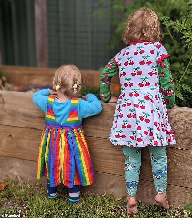 Soil can be contaminated by leaded paint peeling off old houses or because petrol fumes are trapped within the soil. Pictured: Juno, 1, and Orion admiring their vegetable patch