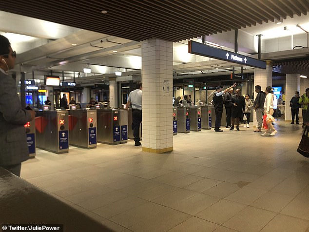 Sydney's Town Hall train station was evacuated about 11am on Wednesday after a 'suspicious package' had been reported to authorities. Pictured, police at the station