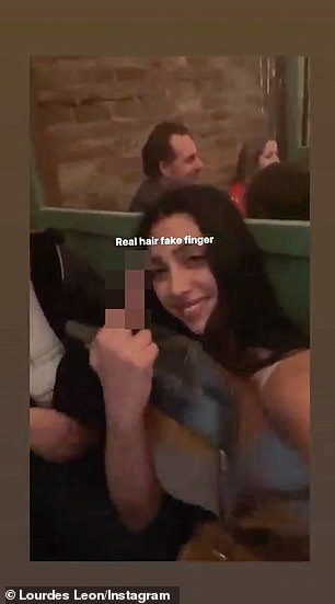On Tuesday night, Lourdes instastated a video of herself waving to the middle finger as her bearded friend stroked her locks at the waist.