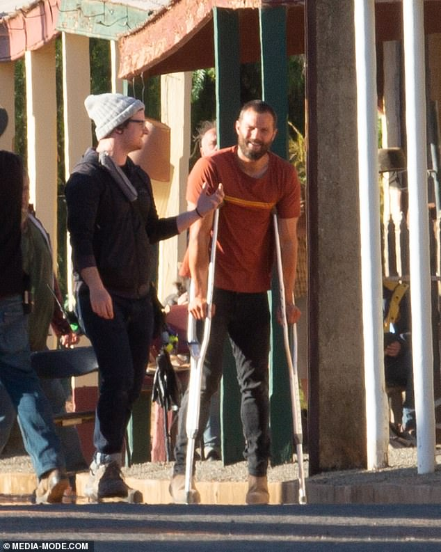 It's not that bad! The famous Northern Irish star was spotted sharing a laugh with the film crew at one point