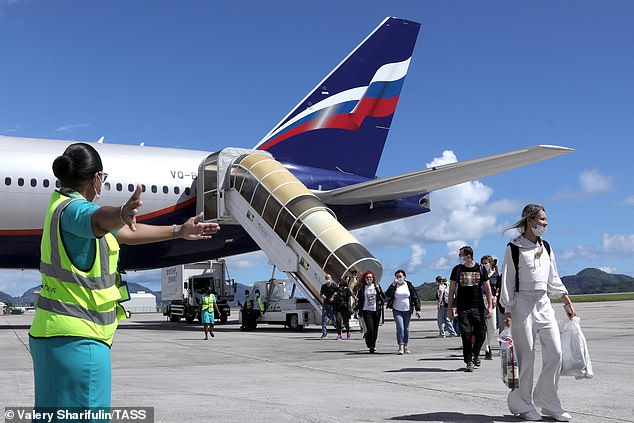 Pictured: Passengers leave a Boeing 777-300ER aircraft that made Aeroflot - Russian Airlines' first SU244 flight to Mahe Island since the start of the COVID-19 pandemic on April 2, 2021