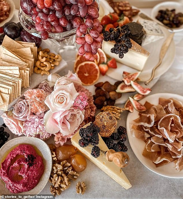 Yummy! The lavish event was perfectly catered for by food artist Lia Townsend.In one image, a table setting is overflowing with mouth-watering grapes, ripe cheeses and tantalising dips alongside nuts, berries and fragrant flowers