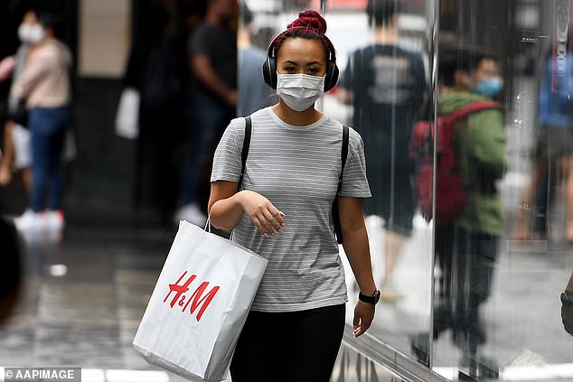 Pictured: A woman in Sydney wearing a mask. Fourteen Sydney suburbs have been put on alert after an infected man in his 50s traversed the city