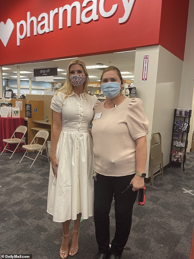Ivanka Trump wore a $684 Alexis dress white shirt dress and a face mask with a brightly colored print pattern for her inoculation