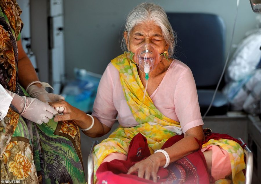 Lilaben Gautambhai Modi, 80, who is suffering from Covid, sits inside an ambulance as she waits to be admitted to a Covid ward inAhmedabad, India