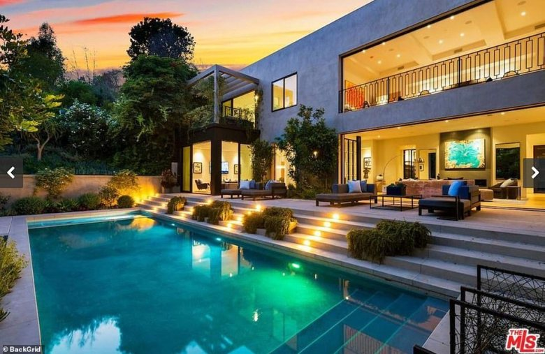 Lovely: Jenner is also reportedly the co-owner of a $13million Beverly Hills investment property with co-parent and sometimes significant other Travis Scott, according to People