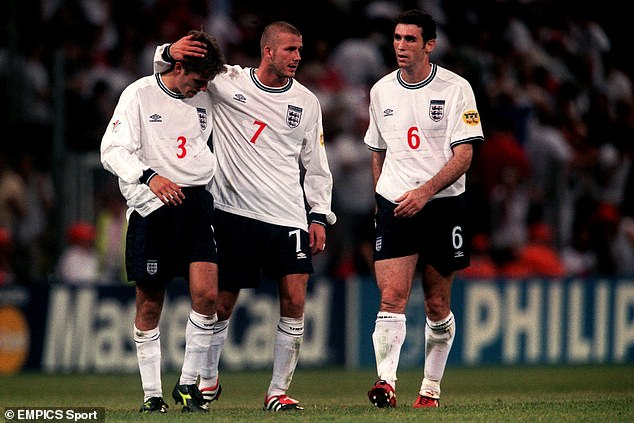 Beckham (7) and Martin Keown (6) look to console Phil Neville at full-time after his foul led to the spot-kick that would see England eliminated at the group stage of Euro 2000