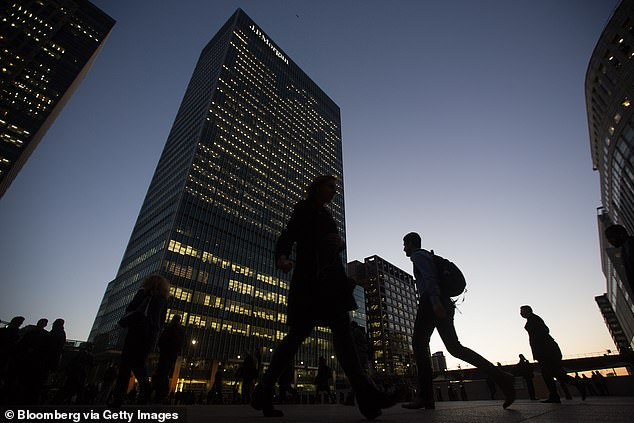 Working in the office part time - with the remainder done at home - will be a model adopted by 43 per cent of the country's biggest companies. JP Morgan (its London HQ pictured) has had some staff back in the office from March 29