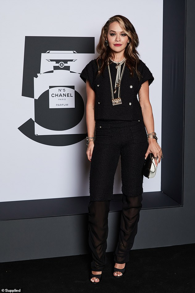 Later that night: Rita oozed sophistication in a $12,000 Chanel ensemble as she attended an event to celebrate 100 years of the fashion house's No.5 perfume on Wednesday