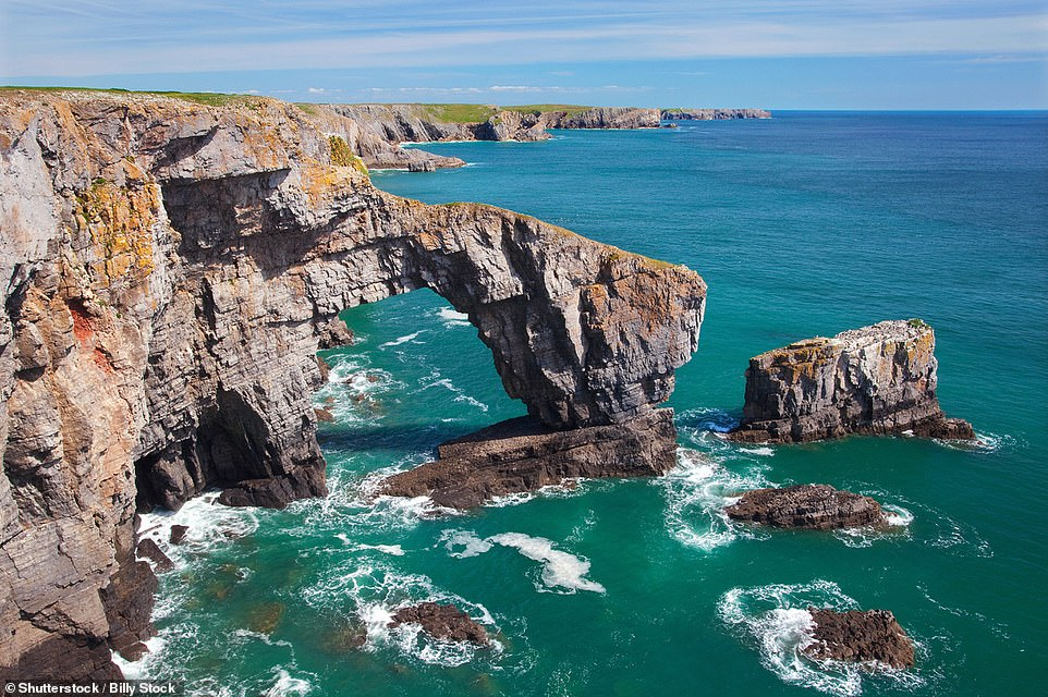 The Green Bridge, located withinthe Pembrokeshire Coast National Park in Wales, is a magnificent limestone arch that is 80ft (24.3m) tall at its highest point. Visiting the natural wonder is tricky as a nearby army range often leads to road closures and climbing is restricted at certain times of the year due to nesting sea birds