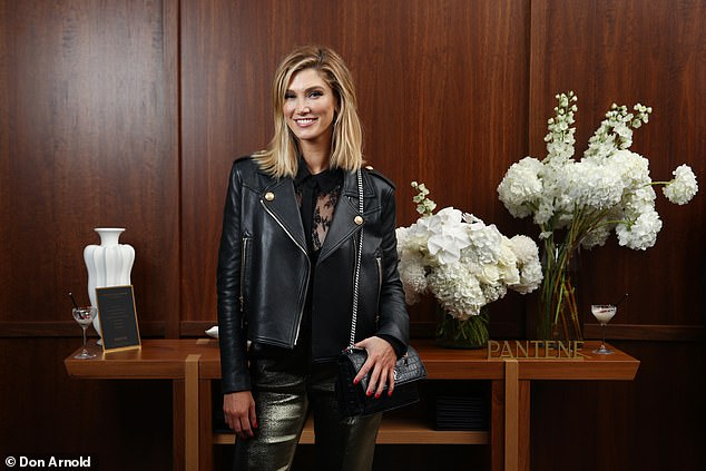 Stepping out in style:The Born to Try singer, 36, looked edgy in a black leather jacket and metallic pants as she stepped out for the soirée