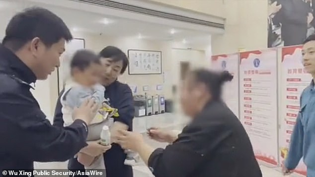 Xiewas given custody of the his son,nicknamed Jiajia (pictured being reunited with family by police) after divorcing his wife, who was given custody of their daughter