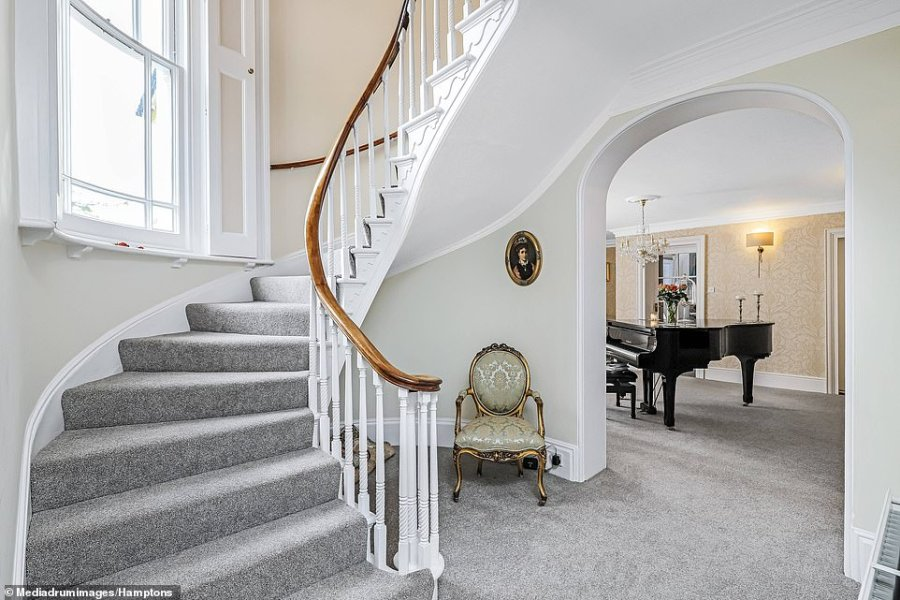 Even though it has been modernised, the home still features an impressive Victorian staircase and log burner