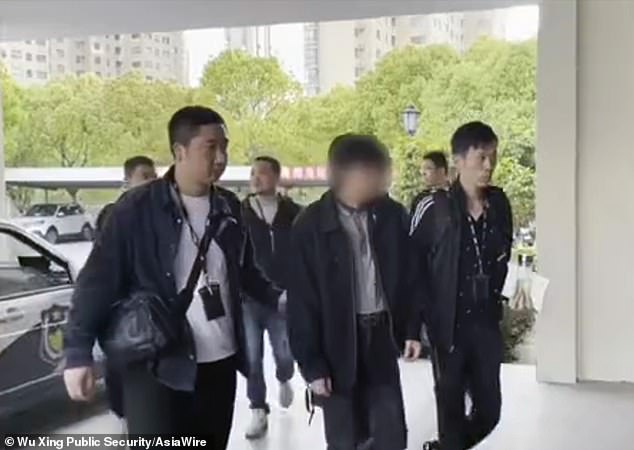 A man,identified by his surname Xie (centre), from the Chinese province of Zhejiang, has been arrested for allegedly selling his son, two, and using the cash to go travelling with his new lover