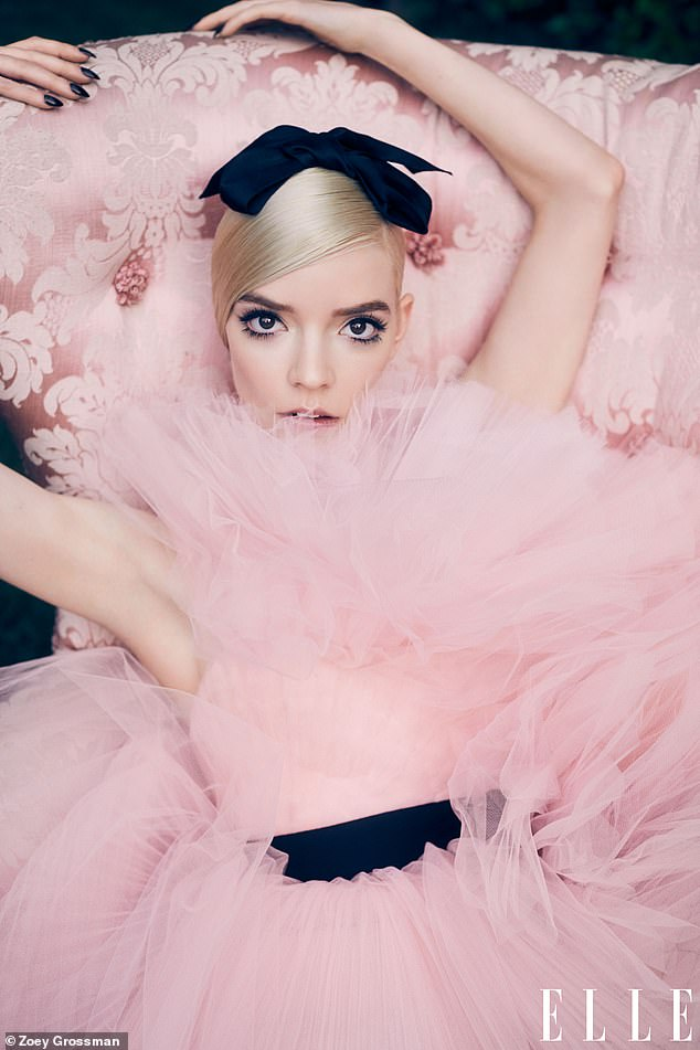 Pretty in pink:For one look during the photoshoot, the actress modelled a striking pink ruffled tulle mini dress which had a black belt to cinch in her svelte waist