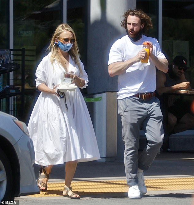 United:Aaron Taylor Johnson, 30, and his wife Sam, 54, put on a united front as they grabbed a takeaway lunch together in Calabasas on Wednesday