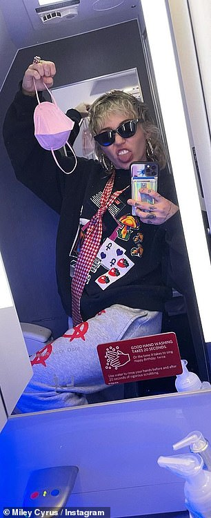 The singer goofed around for the camera in the tiny airline bathroom