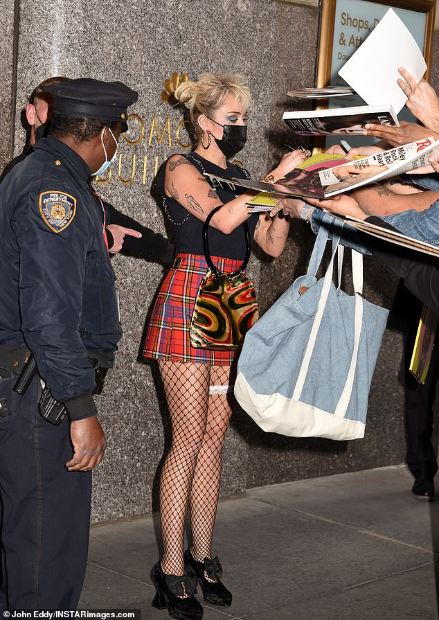 Gracious: She spent a little time signing autographs before getting into her ride back to the hotel