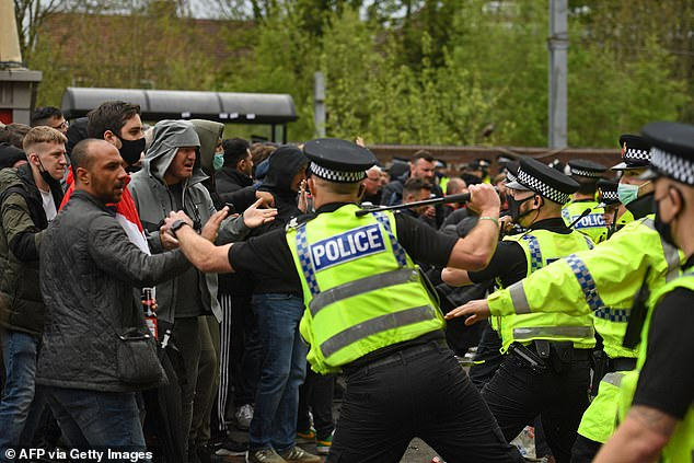 Some police officers were injured after being pelted with bottles by protesting United fans