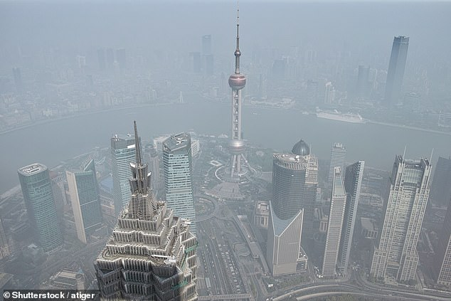 China has tripled its emissions levels since the 1990s, crossing the 19 gigatons threshold for the first time ever the year before last. Pictured: smog over Shanghai (stock image)