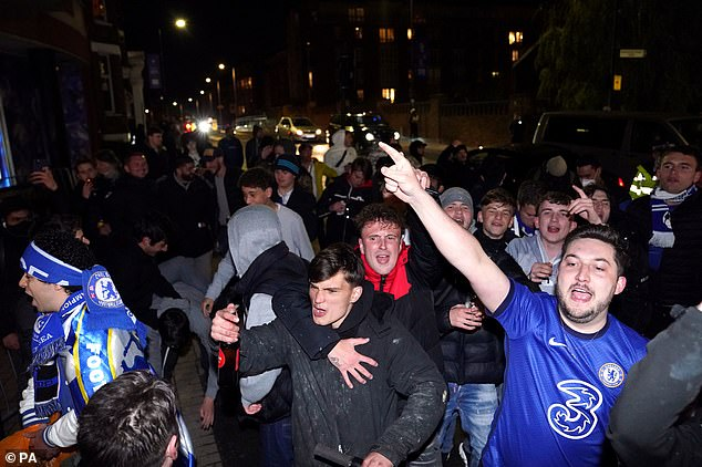 Chelsea fans celebrate outside the ground after beating Real Madrid 2-0 in their semi-final second leg at Stamford Bridge last night