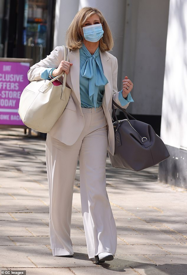 Effortlessly: As she walked, it was possible to see her white boots springing from under the leg of her suit