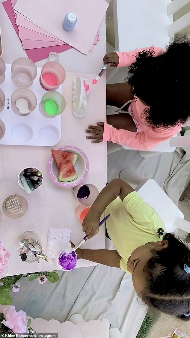 Artists at work: She proceeded to capture True and Chicago using neon colours to paint their ceramic objects