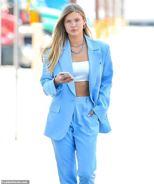 Head-turner: The 24-year-old Victoria's Secret model cut a fashionable figure as she arrived at the Emily Blair Studios