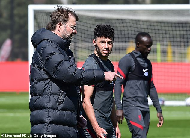 Jurgen Klopp (left) expects Alex Oxlade-Chamberlain (middle) to be part of Liverpool's future