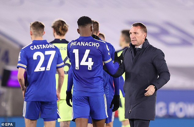 Foxes manager Brendan Rodgers attempts to console his players after the major setback