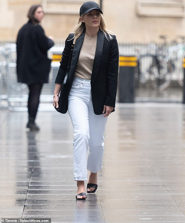 Fashionista: Mollie King added a stylish twist to her smart outfit on Saturday as she teamed her black blazer with a baseball cap for work at BBC Radio 1